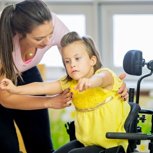 AAC Speech therapy physical therapist lifting child illustrate some of the physical therapy services available.