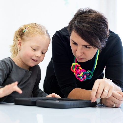 Therapist with child, illustrating the work AAC Speech Therapy does with chidren in Las Vegas and other markets