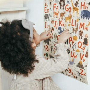 Little girl using a letter board to illustrate AAC services available at AAC speech therapy
