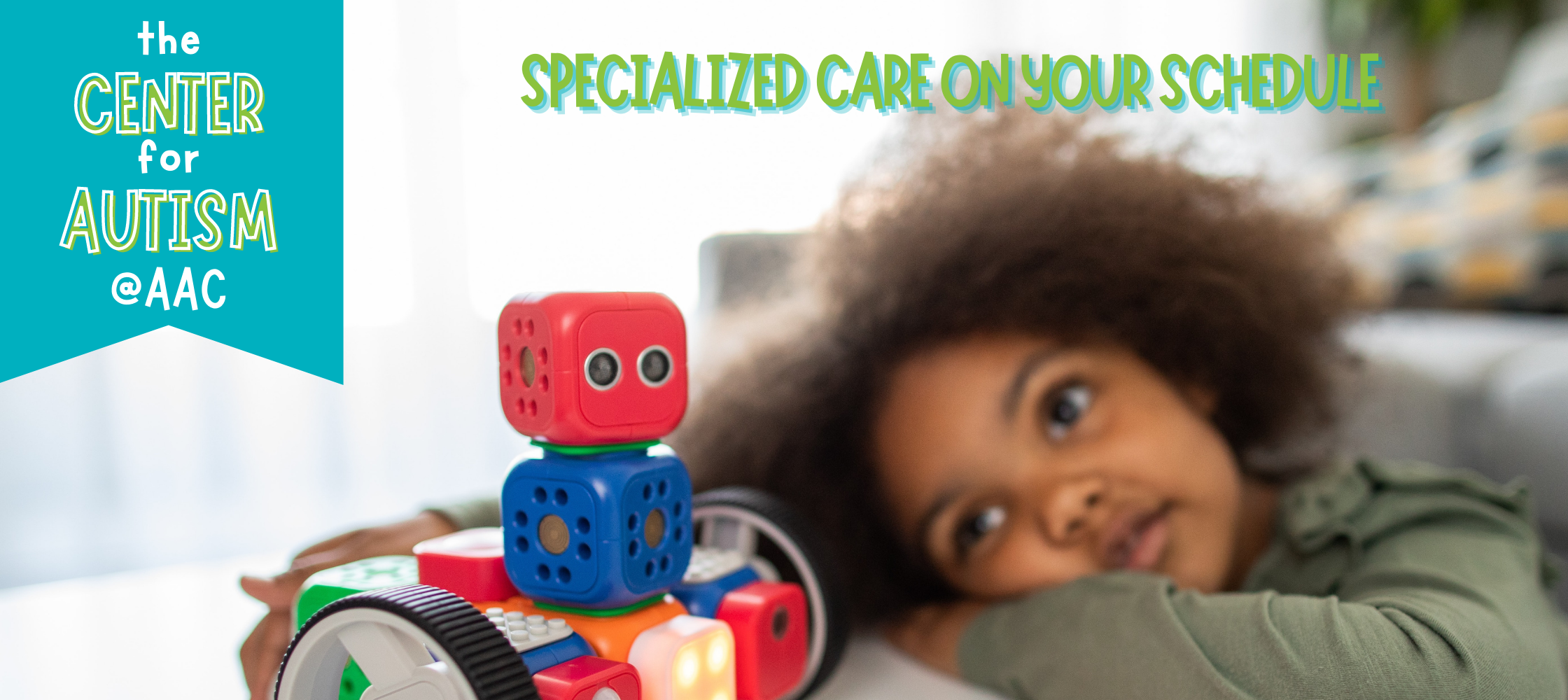 """Photo of young girl with blocks and toys, caption """"The Center for Autism at AAC Las Vegas. Specialized Care on Your Schedule"""""""