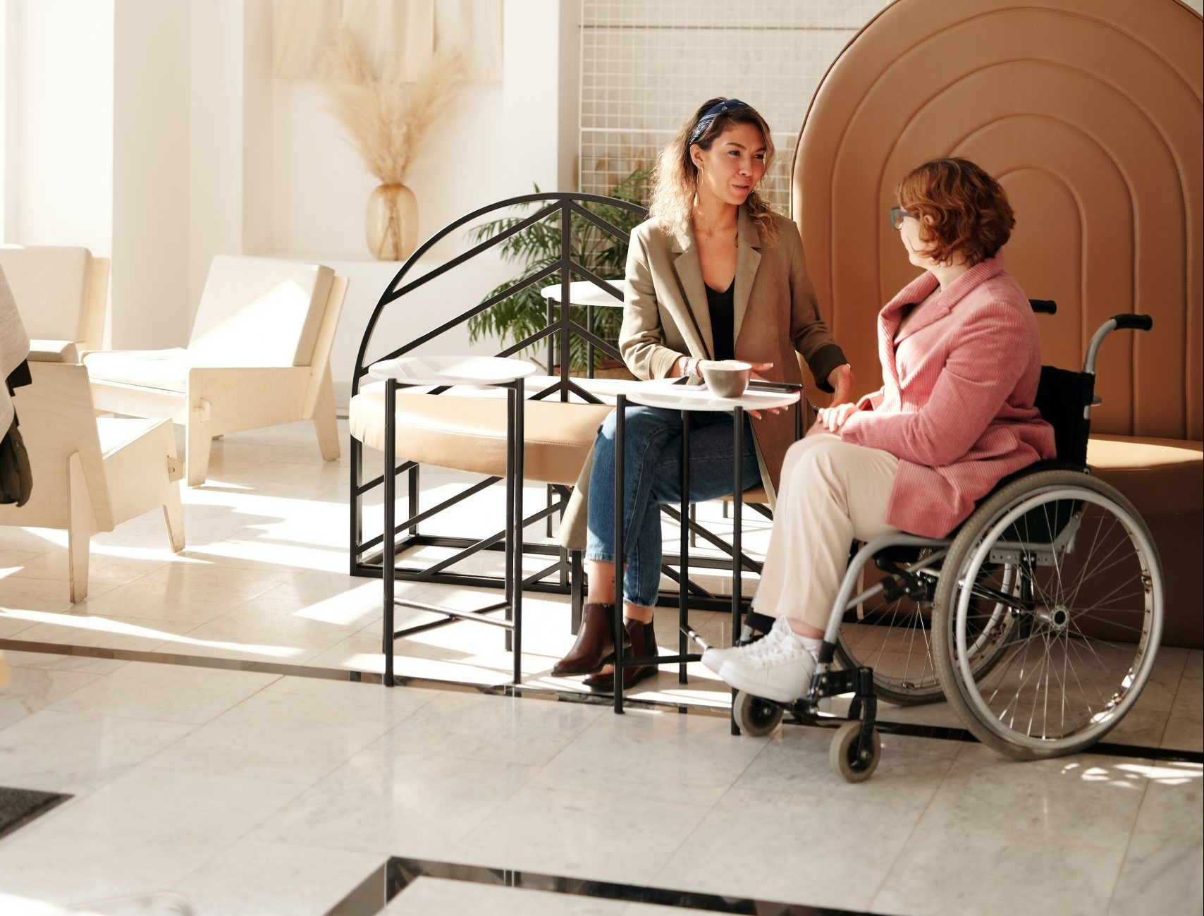 Photo of therapist and elderly patient in wheelchair to illustrate AACs stroke and Early Supported Discharge Services available in Reno, Nevada